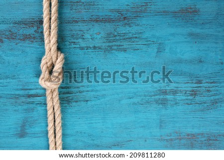 Marine knot on wooden background - stock photo