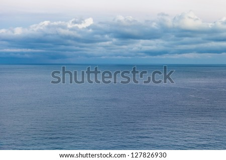 Marine landscape with clouds in a blue tone - stock photo