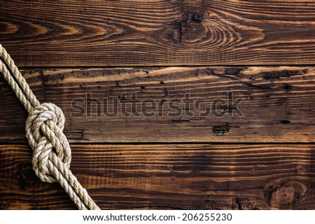 Marine rope on wooden deck - stock photo