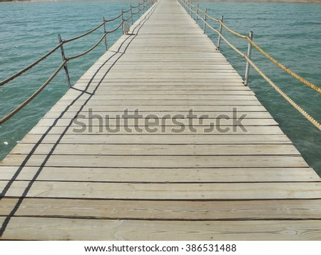 Marine wooden bridge perspective