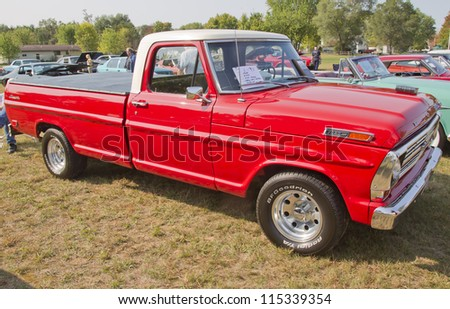 MARION, WI - SEPTEMBER 16: 1969 Ford F100 Ranger Truck at the 3rd Annual Not Just Another Car Show on September 16, 2012 in Marion, Wisconsin. - stock photo