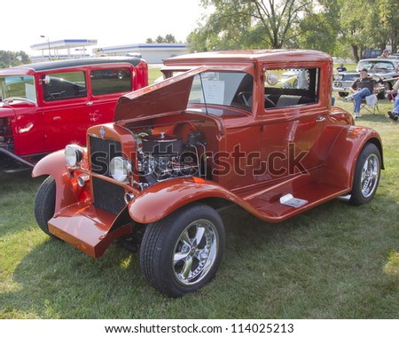 MARION, WI - SEPTEMBER 16: 1930 Orange Chevy Coupe car at the 3rd Annual Not Just Another Car Show on September 16, 2012 in Marion, Wisconsin.