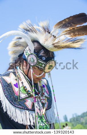 MARIPOSA ,USA - MAY 11 : An unidentified Native Indian man takes part at the Mariposa 20th annual Pow Wow in California , USA on May 11 2013 ,Pow wow is native American cultural gathernig event.