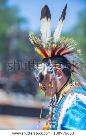 MARIPOSA ,USA - MAY 11 : Unidentified Native Indian man takes part at the Mariposa 20th annual Pow Wow in California , USA on May 11 2013 ,Pow wow is native American cultural gathernig event.
