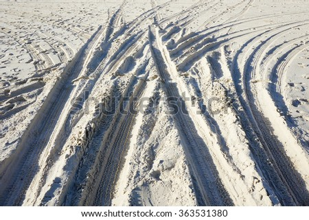 Mark of car rubber on sand - stock photo
