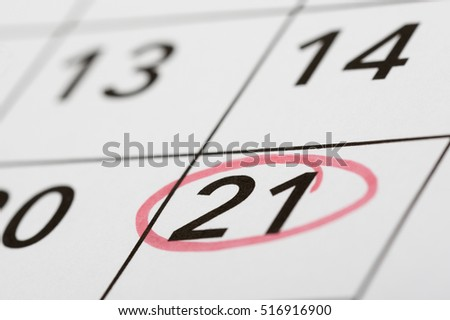 Mark the date number 21. The twenty-first day of the month is marked with a red circle. Focus point on the marked number.