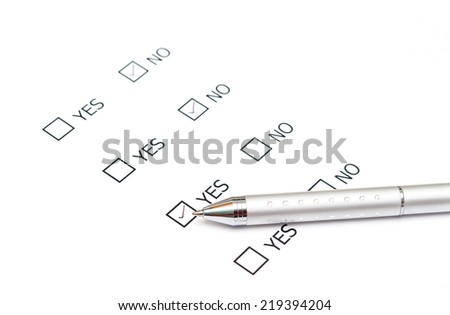 Mark Yes with pen on survey paper document - stock photo