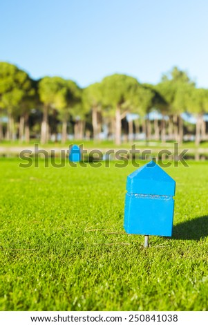 Marker at a teeing ground of a golf course. Shallow DOF, focus on the marker - stock photo