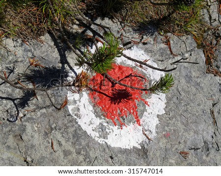 Marker of a path in the  mountains - stock photo