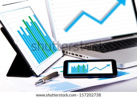 Market analyze chart on laptop tablet and phone - stock photo