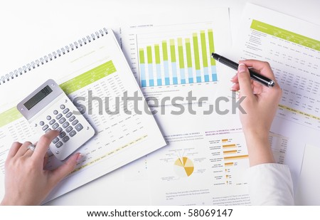 Market Analyze - pen and numbers on paper - stock photo