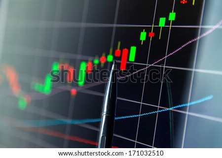 Market analyzing, Business charts and markets on display - stock photo
