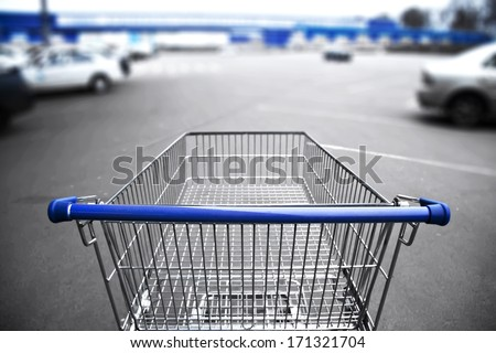 market cart and supermarket view and parking - stock photo