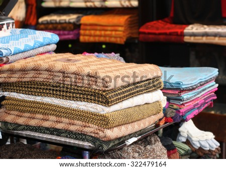 market in Lima Peru selling colorful material - stock photo