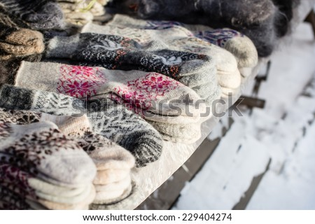 Market in Siberia, Russia: wool socks. Selective focus - stock photo