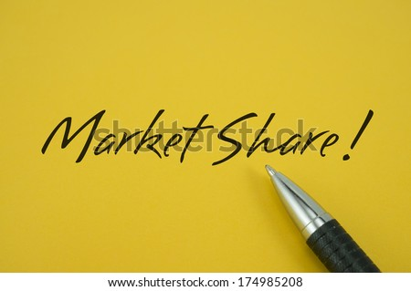 Market Share! note with pen on yellow background