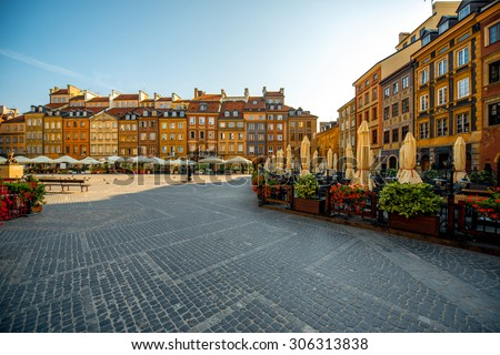 Market square with cafe and restaurants on a beautiful sunny morning in Warsaw, Poland - stock photo