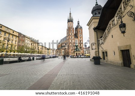 Market square with historic church, cloth hall in Krakow, Poland - stock photo