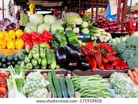 Market stall full of fresh organic fruits and vegetables
