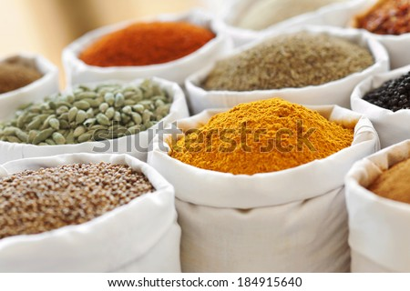 market stall full of spices and herbs - stock photo