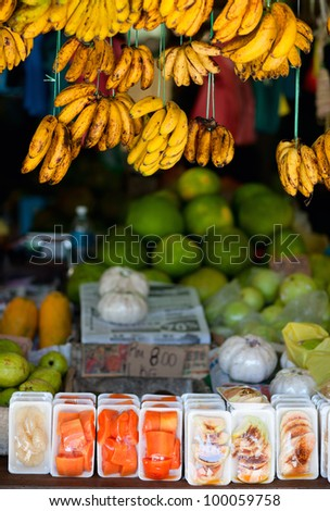 Market stall with bananas and other fruits - stock photo