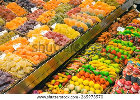 Market stall with sweets at the Boqueria in Barcelona, Spain