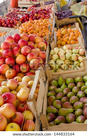Market stalls full of organic fruit in Serbia - stock photo