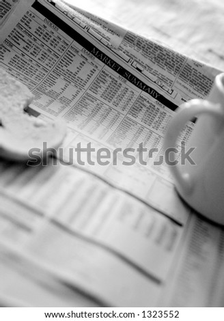 Market summary over coffee and a bagel. - stock photo