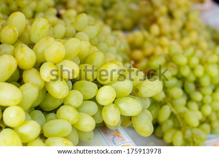 Market table with a bunch of grapes - stock photo