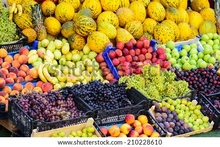 Market with various colorful fresh fruits and vegetables - stock photo