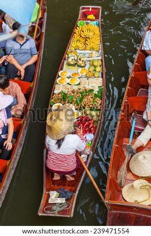 market woman with a boat on the famous floating market Damnoen Saduak in Bangkok, Thailand - stock photo