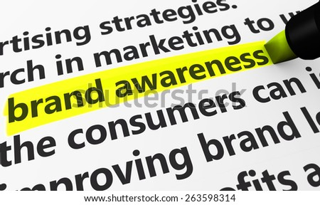 Marketing and advertising concept with a 3d rendering of brand developing strategies related words and brand awareness text highlighted with a yellow marker. - stock photo