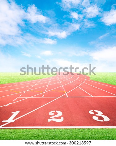 Marketing and business competition positioning concept for advertisement background on running tracks One Two Three with green grass field and blue sky
