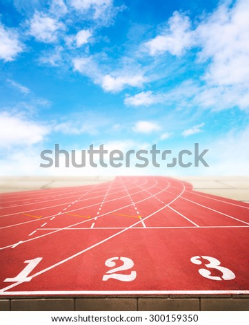 Marketing and business competition positioning concept for advertisment background on running tracks One Two Three with pale blurred brick wall and blue sky