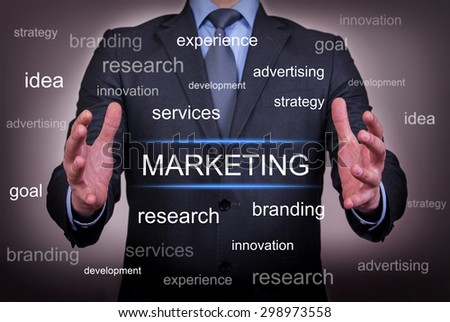 Marketing Between Two Hand - stock photo