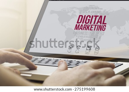 marketing digital concept: man using a laptop with computer generated digital marketing interface on the screen - stock photo