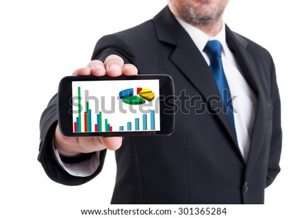 Marketing manager holding smartphone with growing financial chart and piechart isolated on white - stock photo