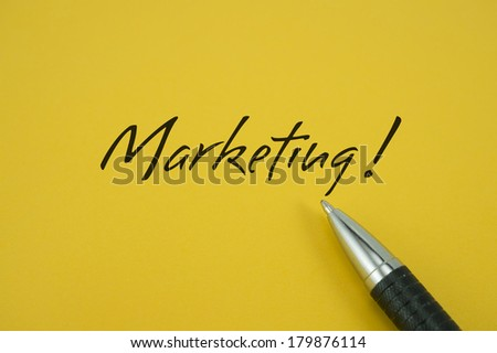 Marketing! note with pen on yellow background - stock photo