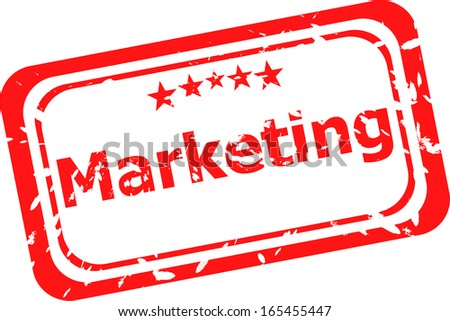 marketing on red rubber stamp over a white background