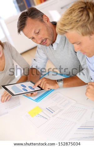 Marketing people working on business plan