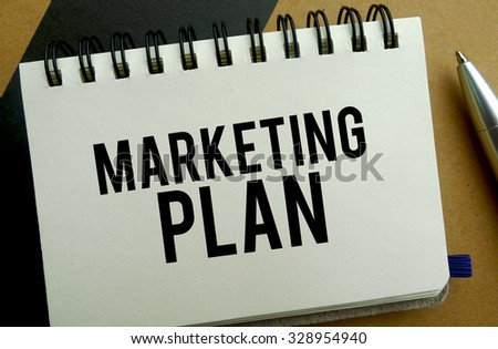 Marketing plan memo written on a notebook with pen
