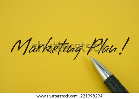 Marketing Plan! note with pen on yellow background
