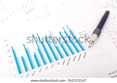 Marketing report chart and graph analysis with pen