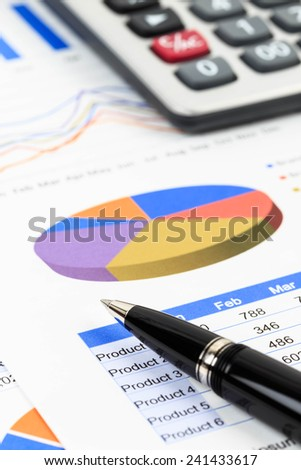 Marketing report chart and graph analysis with pen and calculator