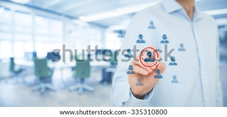 Marketing segmentation and targeting, personalization, individual customer care (service), CRM and leader concepts. Human resources officer select one person, office out of focus in background. - stock photo