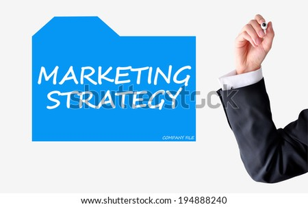 Marketing strategy concept with businessman writing on a file - stock photo