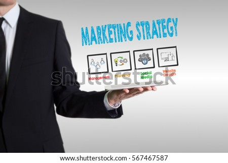 Marketing Strategy concept, young man holding a tablet computer