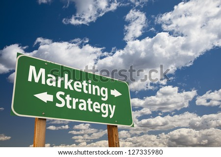 Marketing, Strategy Green Road Sign Over Dramatic Clouds and Sky. - stock photo