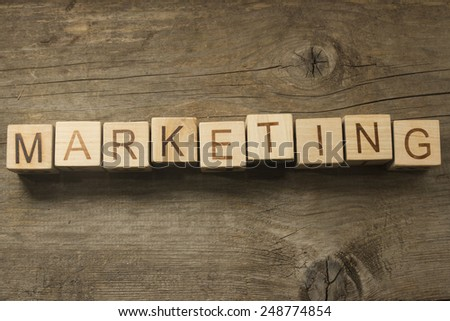 Marketing text on a wooden background - stock photo