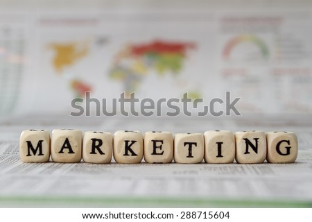 Marketing word built with letter cubes - stock photo
